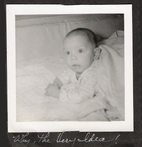 Photo caption of old photo of baby looking surprised